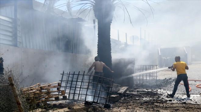 İzmir'de otluk alanda çıkan yangın konteyner fabrikasına sıçradı